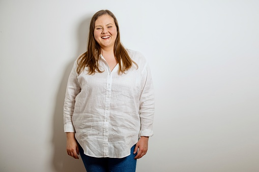 Portrait of a confident plus size woman. Oversized woman posing and looking at camera on white background. Body Confidence, Body Positivity And Self Esteem