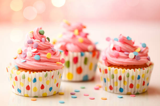 Cheerful Polka Dot Cupcakes Homemade birthday party cupcakes with colorful polka dots. cupcake stock pictures, royalty-free photos & images