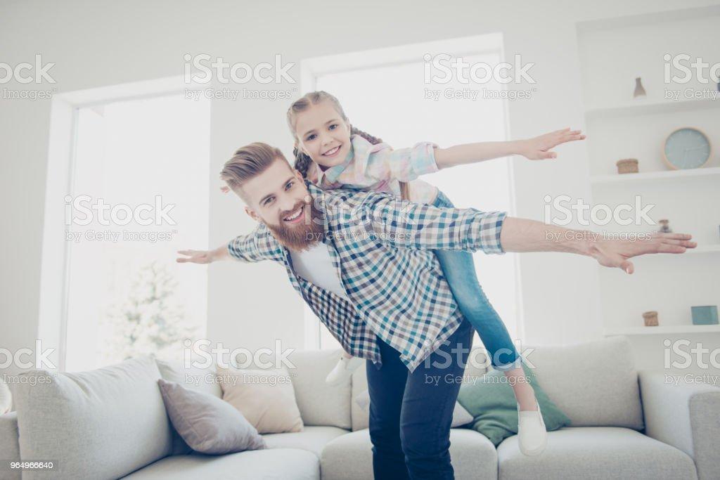 Cheerful positive creative joyful trendy family with one parent...