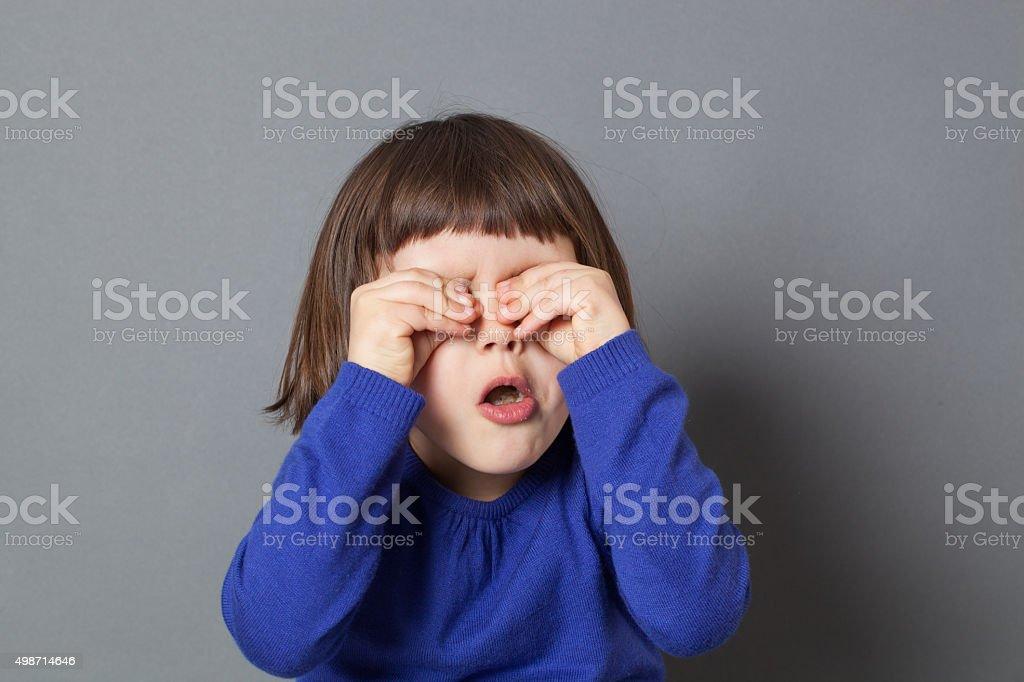 cheerful preschooler hiding eyes for fun peek-a-boo game stock photo