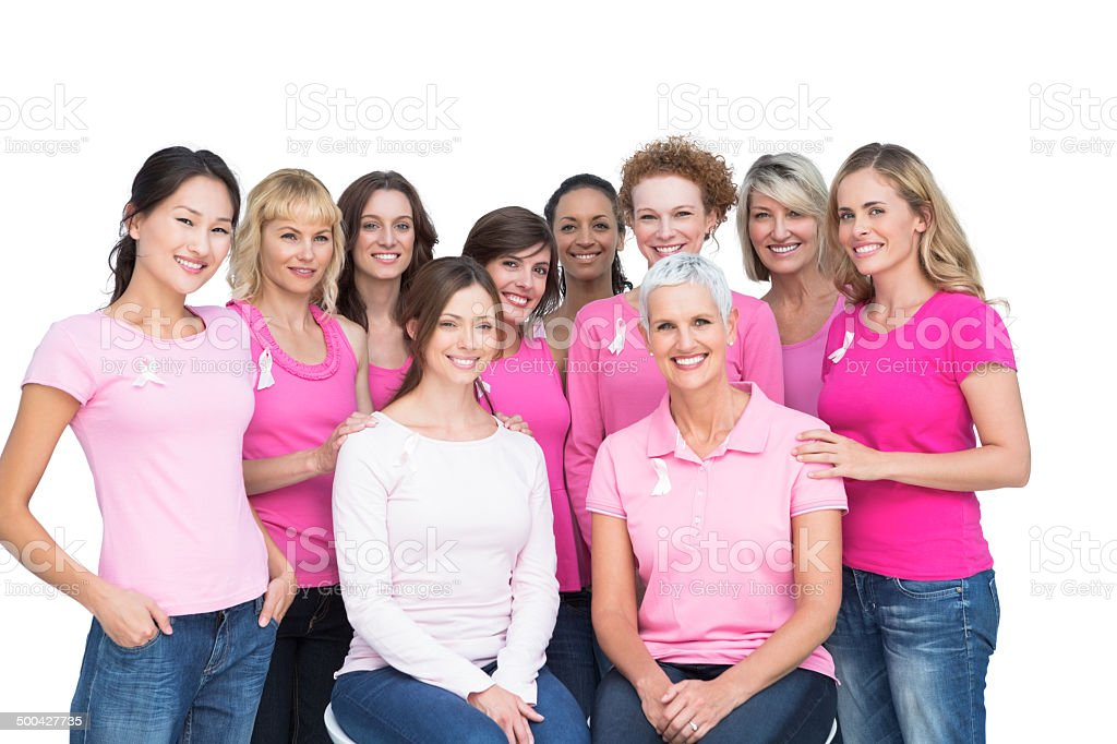 Cheerful pretty women posing and wearing pink for breast cancer stock photo
