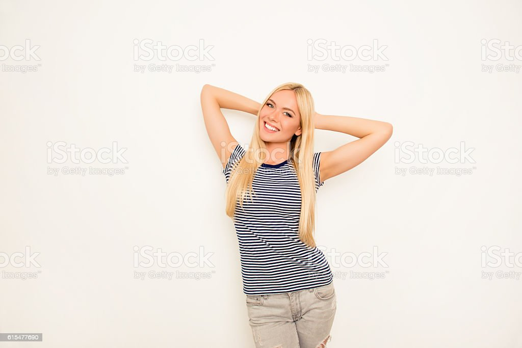 Cheerful pretty young woman dreaming on white background - Photo