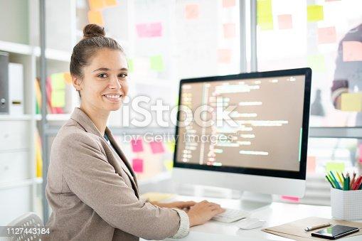 istock Cheerful programmer 1127443184