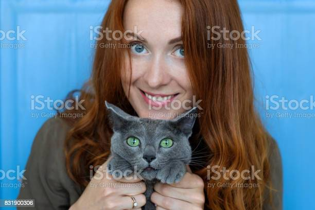 Cheerful redhead girl plays with her blue cat picture id831900306?b=1&k=6&m=831900306&s=612x612&h=ry65rnkgrnmj8uyfk0ncryllh9b9eqkroiukd56ezkw=