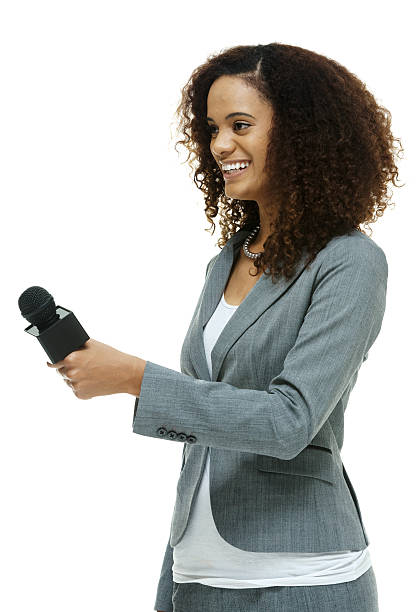 Cheerful reporter in action with microphone stock photo