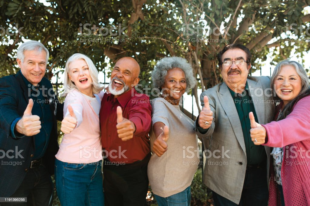 Cheerful retired senior friends showing thumbs up - Royalty-free 60-64 Years Stock Photo