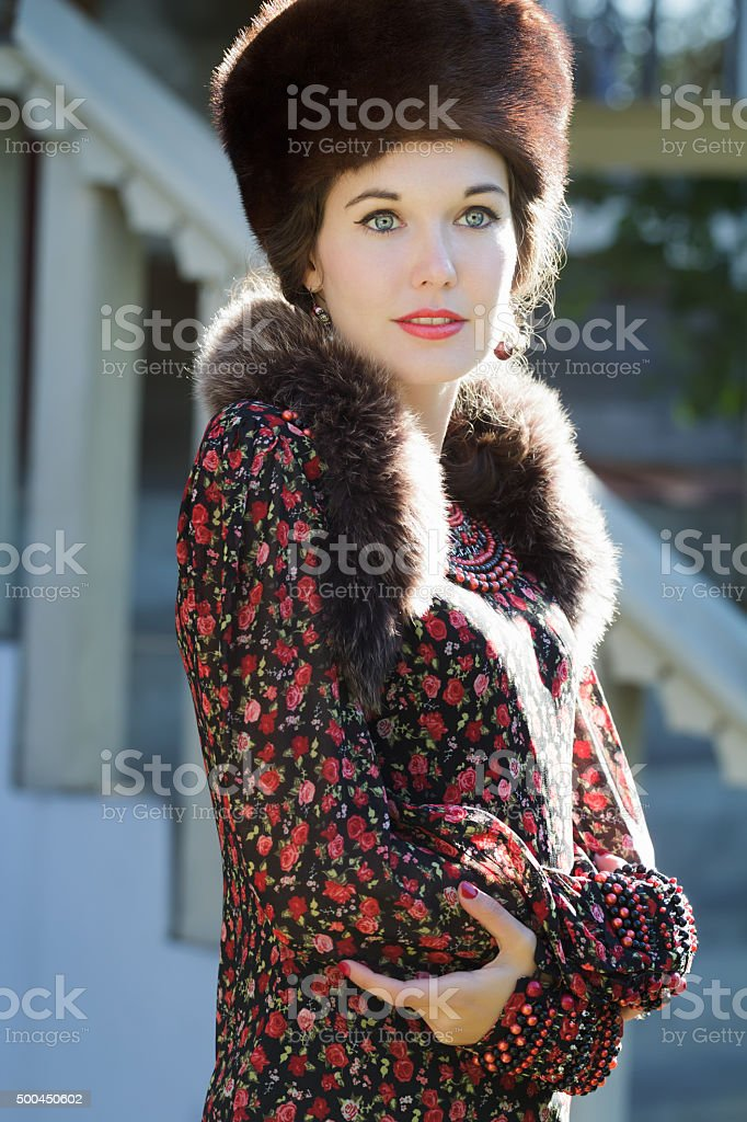 cheerful russian beauty in traditional fur cossack hat stock photo