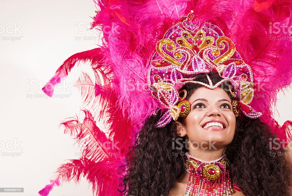 Cheerful samba dancer wearing pink costume stock photo