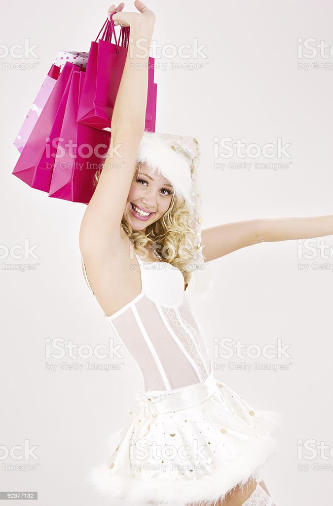 cheerful santa helper girl with shopping bags royalty-free stock photo