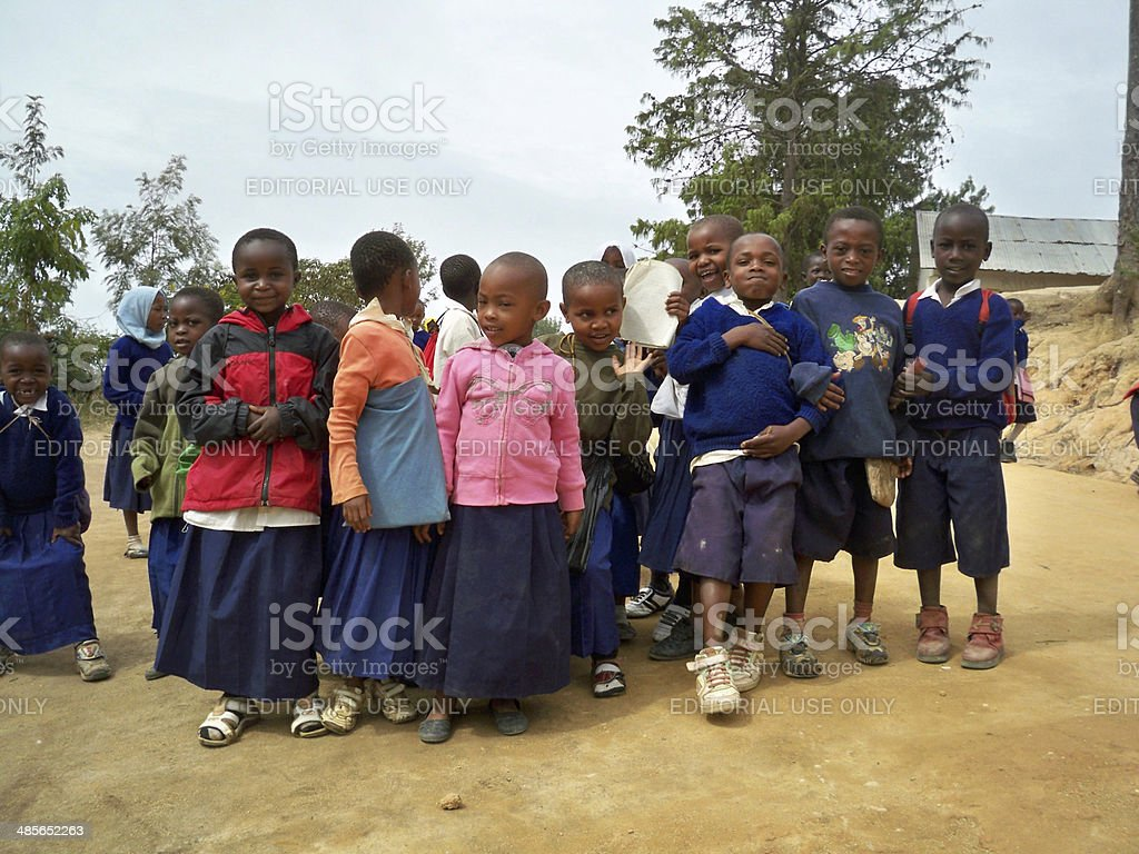 Cheerful school children standing outside during a lunch break