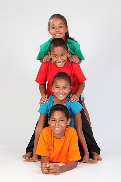 Cheerful school friends boys and girls form human totem-pole stock photo