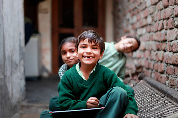 cheerful school students portrait at home - village stock pictures, royalty-free photos & images