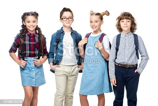 1016623732istockphoto cheerful schoolchildren looking at camera isolated on white 1016623228