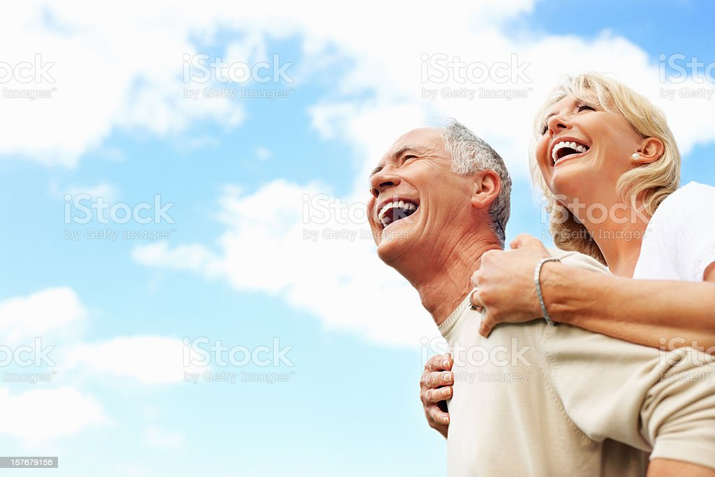 Cheerful senior couple against sky royalty-free stock photo