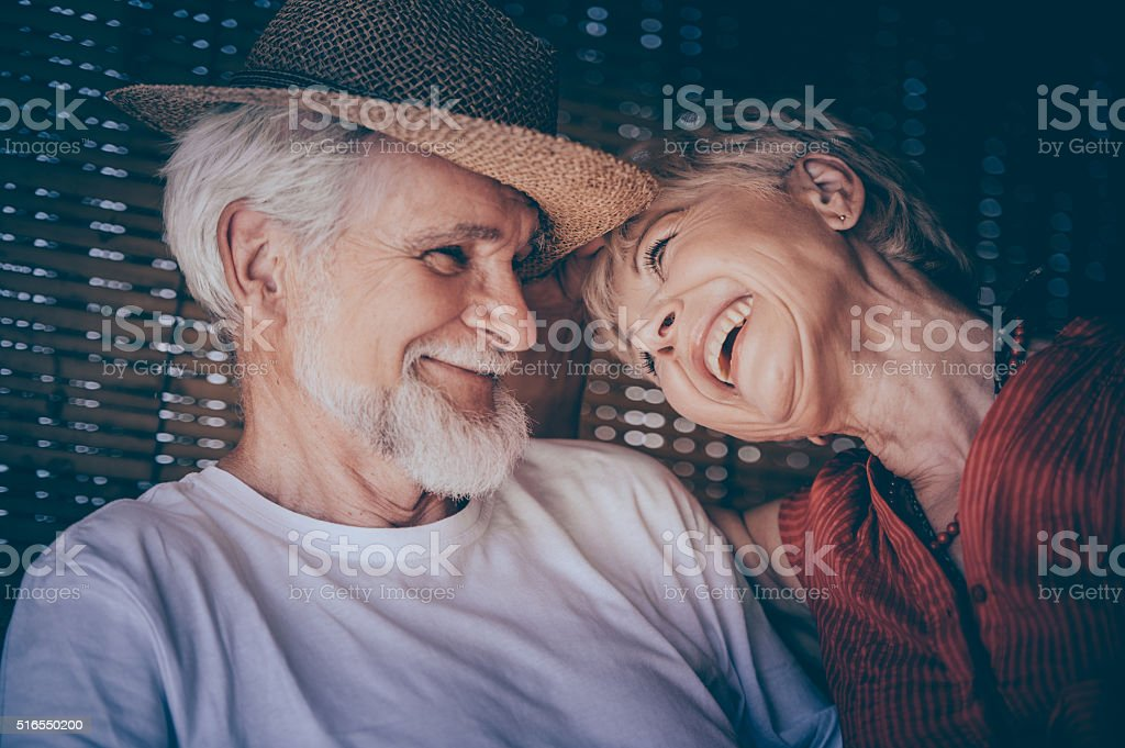 Cheerful Senior Couple Enjoying Summer Day on a Terrace stock photo
