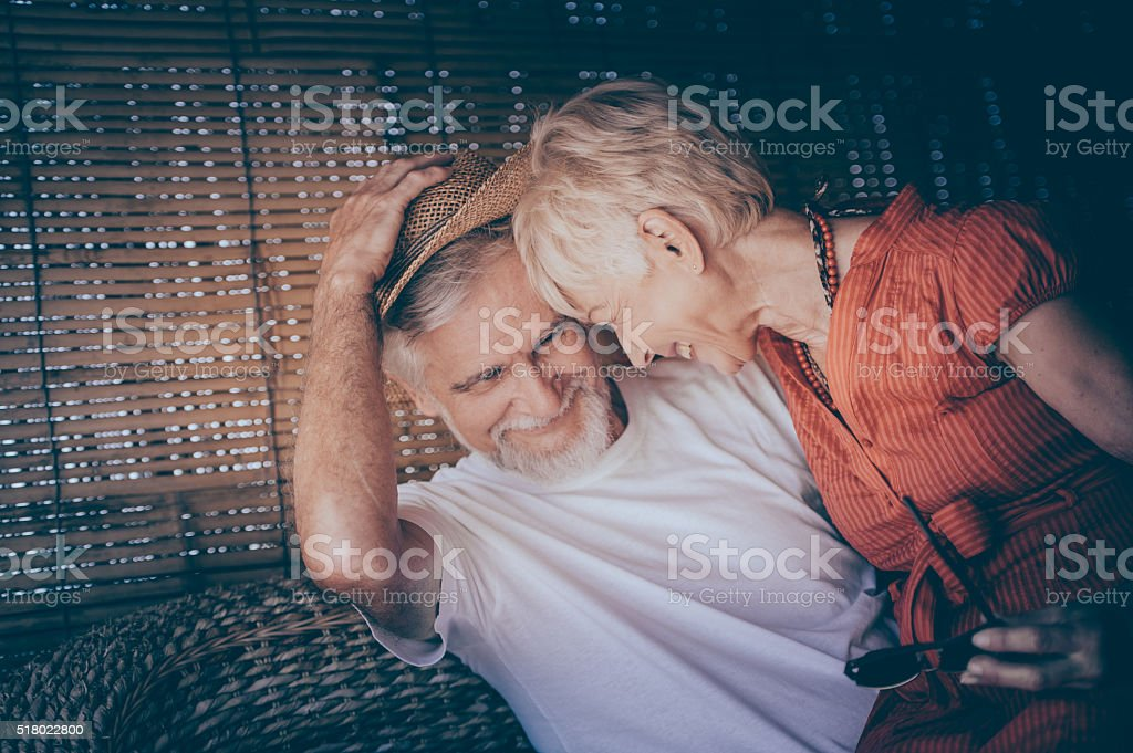Cheerful Senior Couple Enjoying Summer Day on a Terrace stock photo