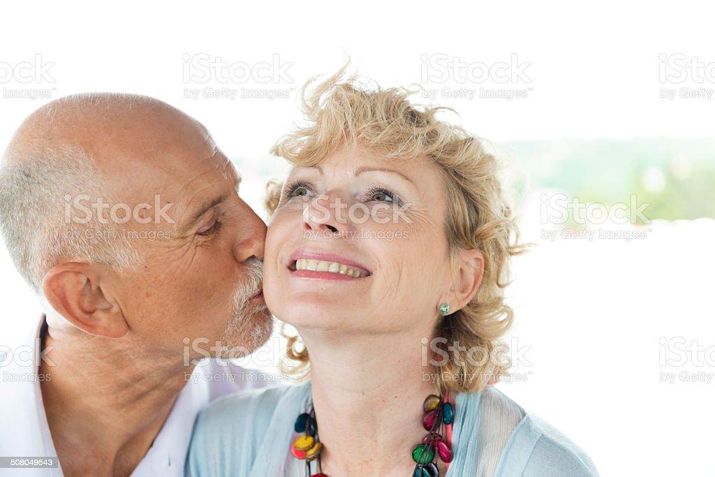 Cheerful Senior Couple Enjoying Summer Day on the Beach royalty-free stock photo