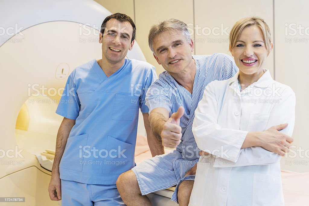 Cheerful senior man and doctors after MRI scan. royalty-free stock photo