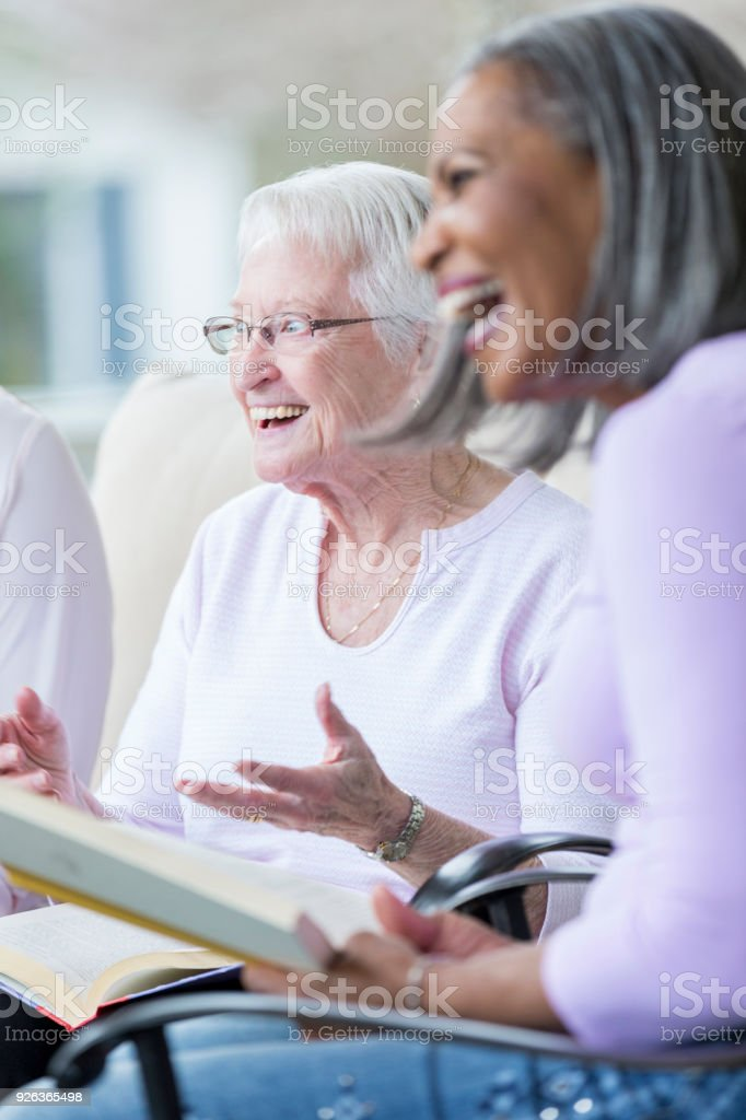 Cheerful senior woman during book club stock photo