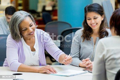 956725740istockphoto Cheerful senior woman enjoys studying with university classmates 962638128
