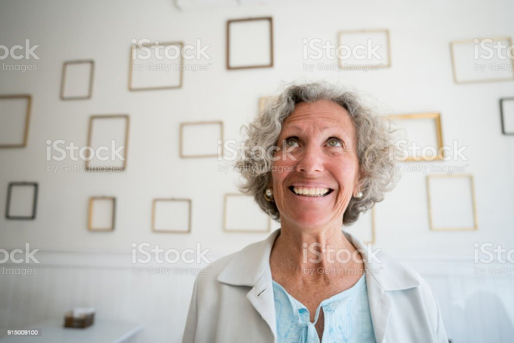 Cheerful Senior Woman Looking Up Daydreaming And Empty Picture ...