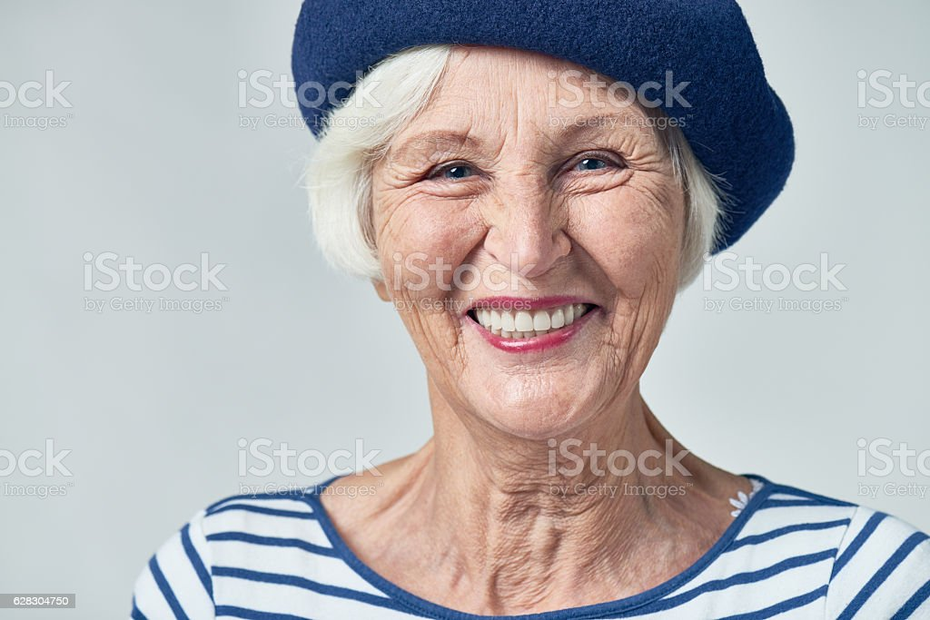 Cheerful senior woman with wide smile stock photo