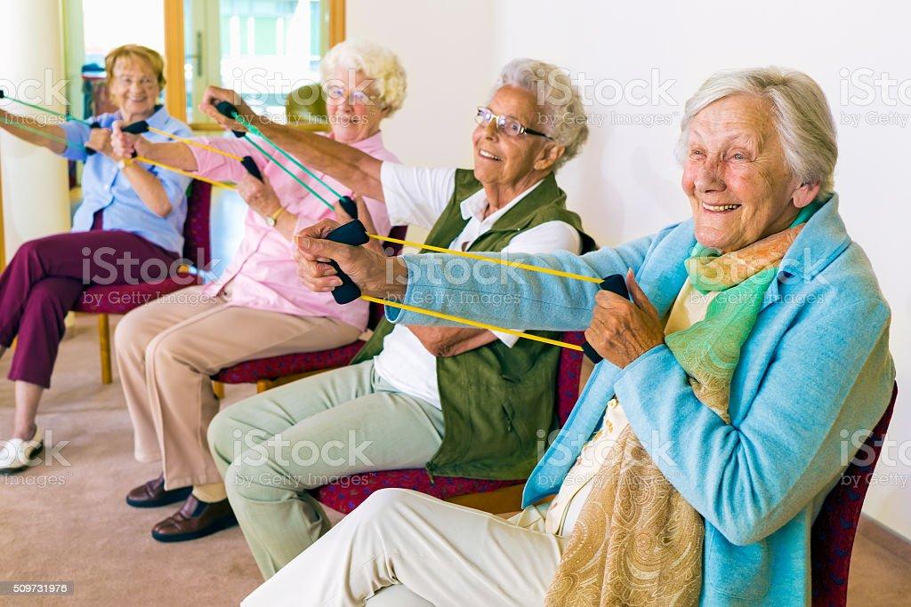 Cheerful senior women exercising their arms. stock photo