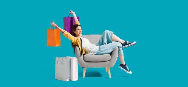 Cheerful shopaholic woman with shopping bags stock photo