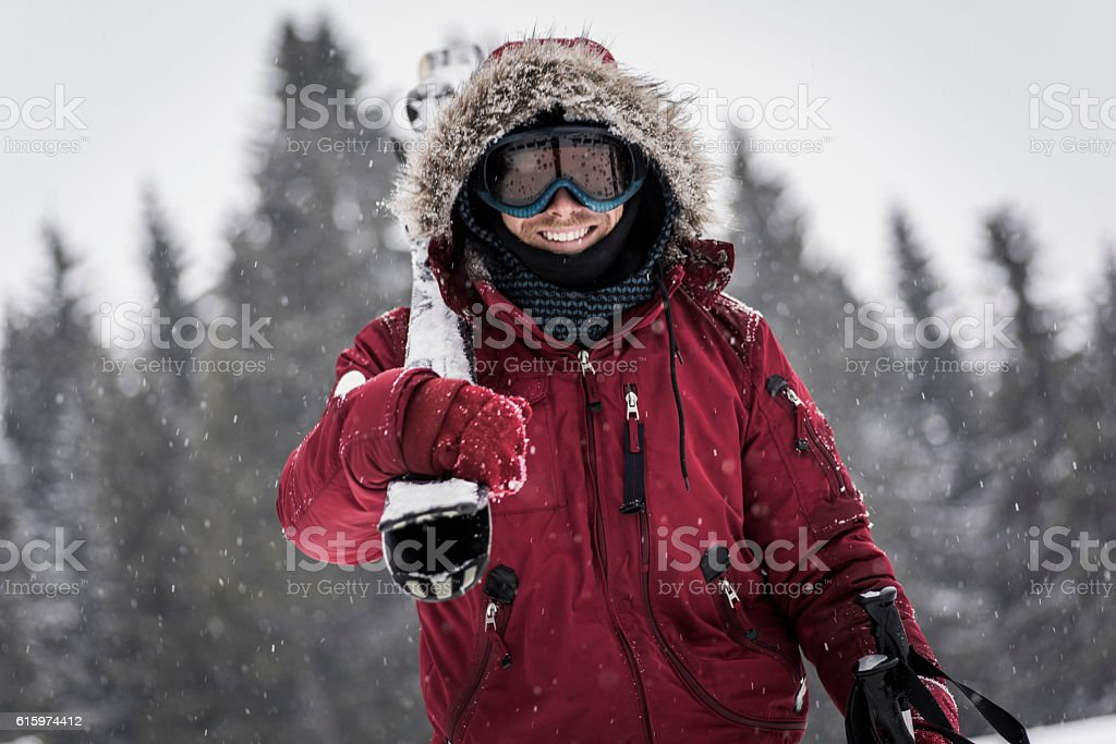 Cheerful skier posing stock photo