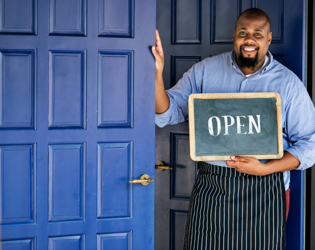 a cheerful small business owner with open sign - owner stock pictures, royalty-free photos & images