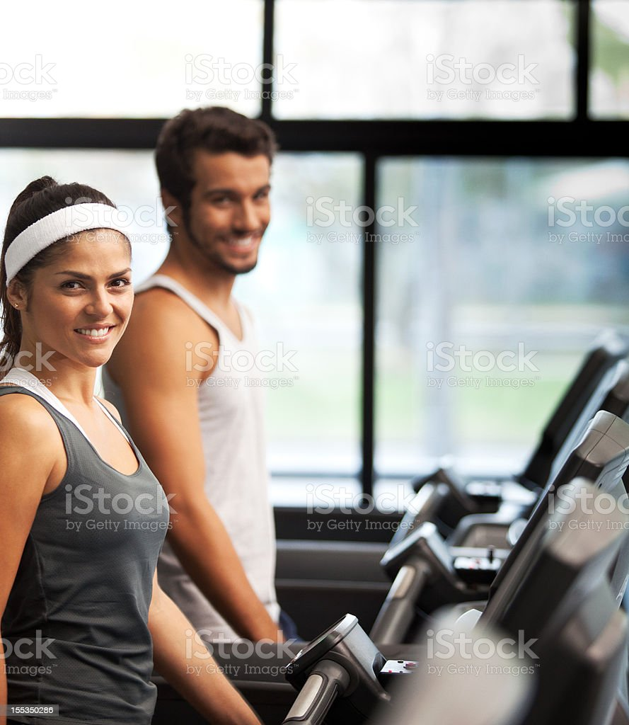 Cheerful smiling and beautiful people running at the fitness club. royalty-free stock photo