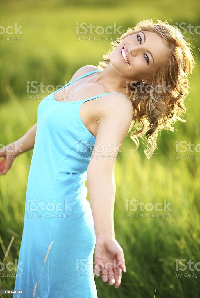 Cheerful smiling blond woman on a meadow. stock photo