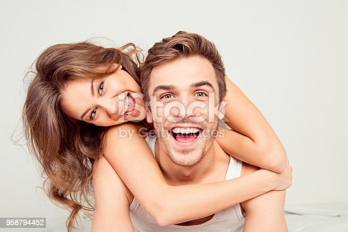 istock Cheerful smiling couple in love hugging in the bedroom 958794452