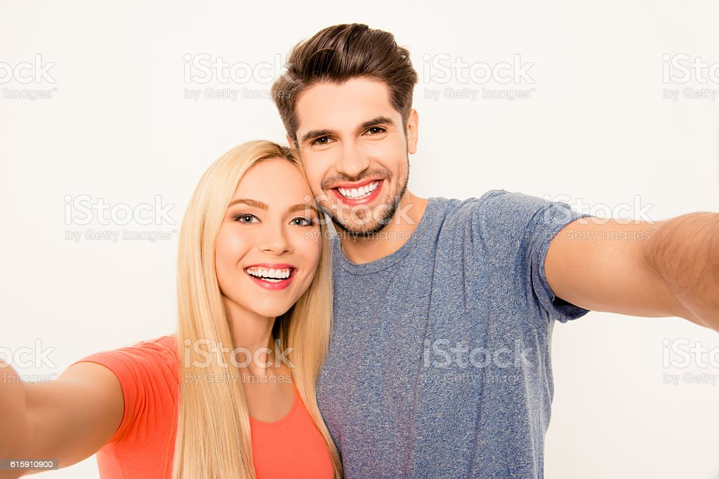 Cheerful smiling happy man and woman making selfie - foto de acervo
