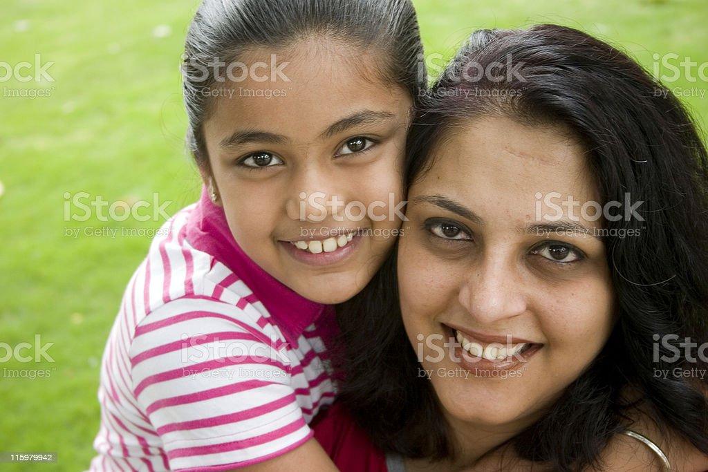 Cheerful Smiling Loving Indian Mother Daughter Hug Embracing Horizontal Grass royalty-free stock photo