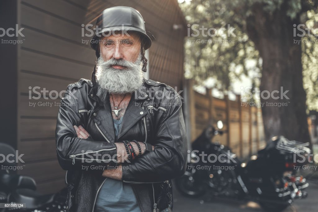 Cheerful smiling old man in helmet stock photo