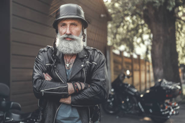 cheerful smiling old man in helmet - biker stock photos and pictures