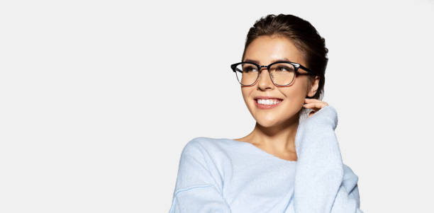 Cheerful smiling woman in glasses  looking away stock photo