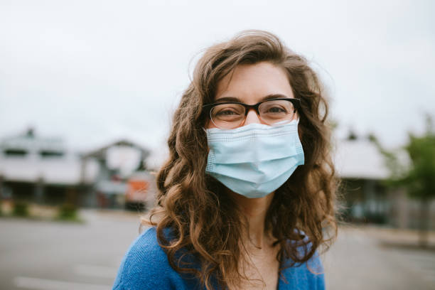 Cheerful Smiling Woman Wearing Face Mask