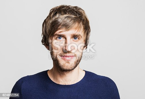 istock Cheerful smiling young man portrait 624652254
