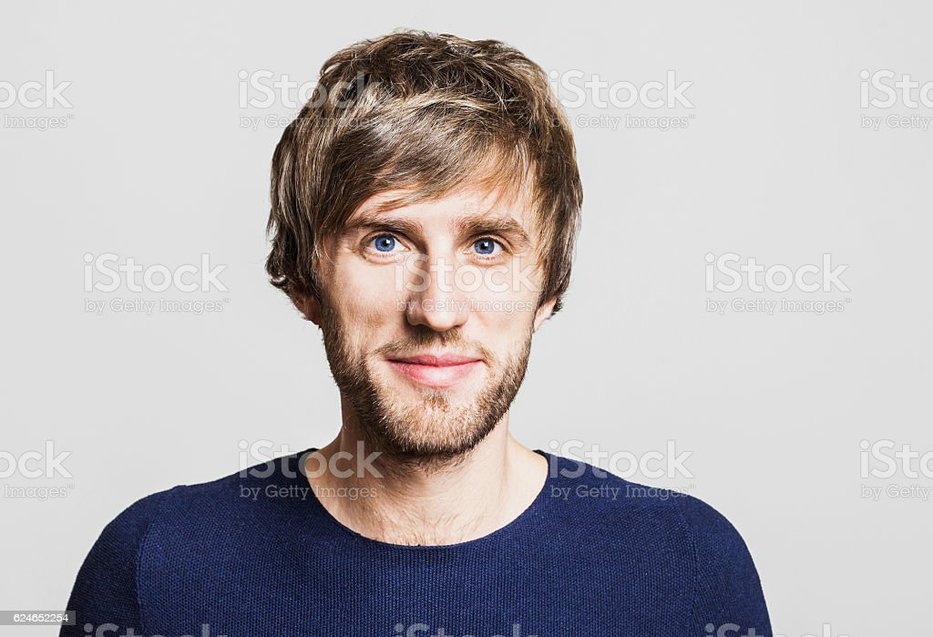 Cheerful smiling young man portrait stock photo