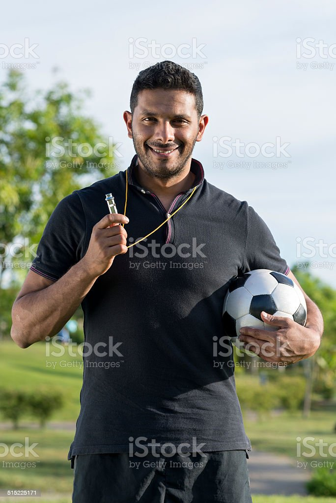Cheerful soccer coach stock photo