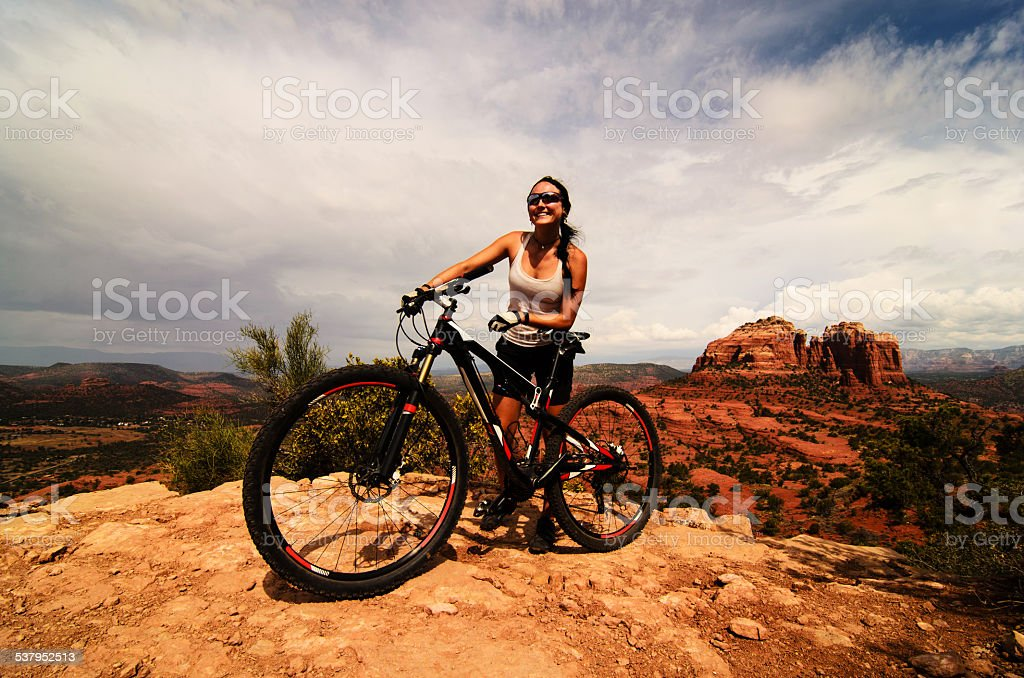 Cheerful sport girl with bicycle stock photo