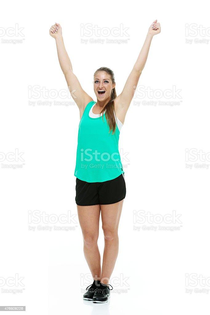 Cheerful sports woman cheering stock photo