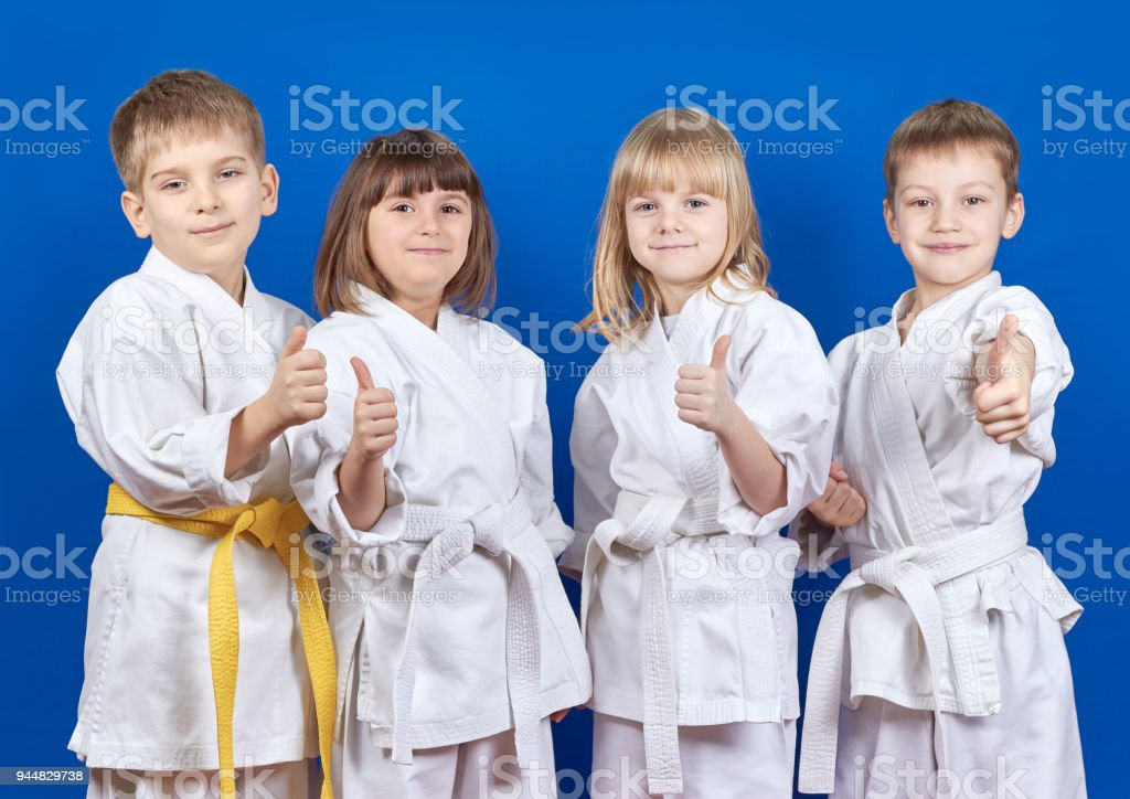 Cheerful sportsmen in karategi are showing finger super