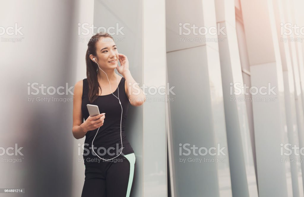 Cheerful sporty woman having rest after workout royalty-free stock photo