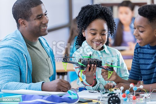 1016655140 istock photo Cheerful STEM middle school students build drone 690657098