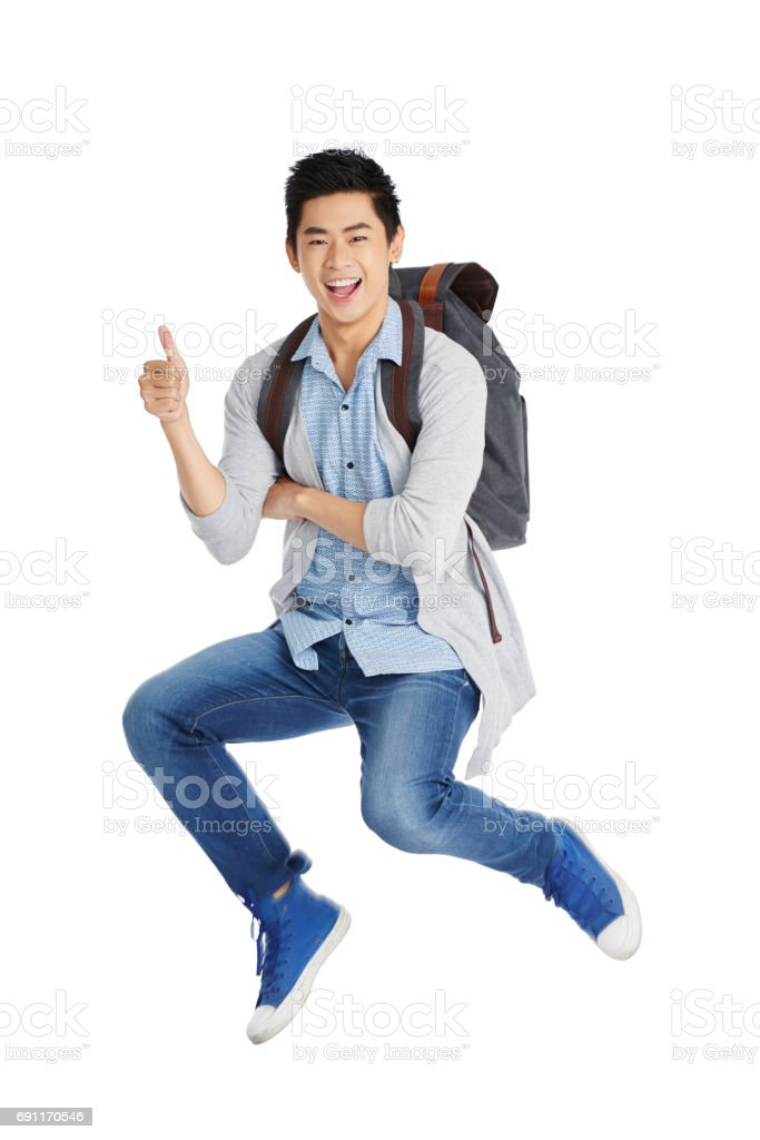 Cheerful Student Showing Thumb Up stock photo