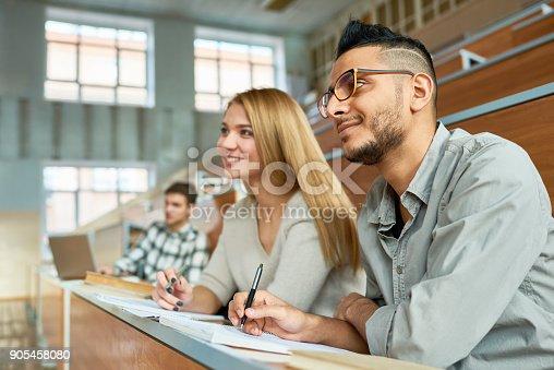 istock Cheerful Students at University 905458080