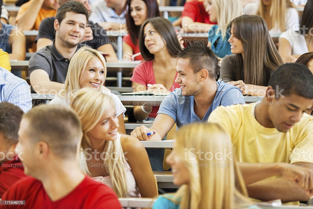 Cheerful students communicating royalty-free stock photo